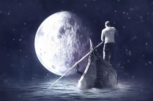 man rowing a gondolier