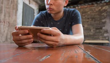 boy playing on mobile game